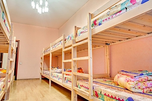 A bed in the 8-bed room in HomeLight hostel, Monolocale, 001