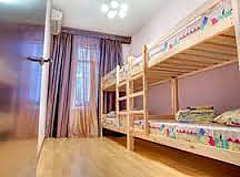 A bed in the 8-bed room in HomeLight hostel, Studio, 001