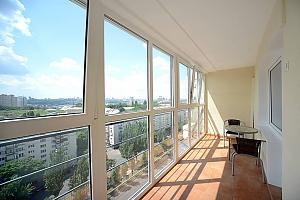 Сногсшибательный вид на город с высоты 15 этажа с вашей собственной террасой в 5 минутах от Gulliver и Arena City, 2х-комнатная, 001