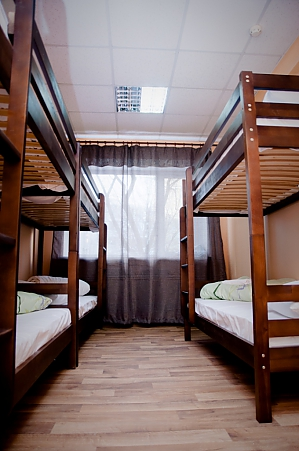A bed in the 8-bed room, Monolocale, 002