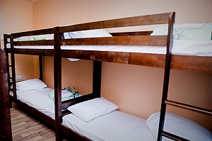 A bed in the 8-bed room, Monolocale, 004