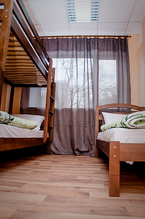 A bed in the 3-bed room, Monolocale, 002